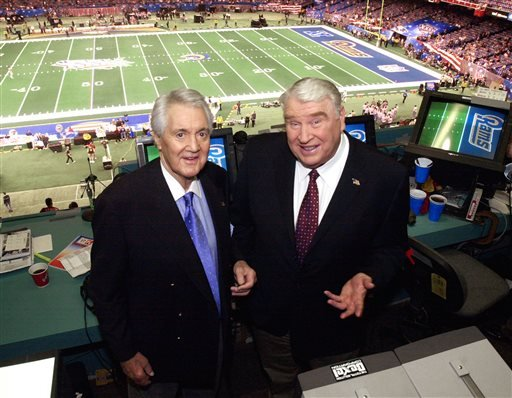 In this Feb. 3, 2002, file photo, Fox broadcasters Pat Summerall, left, and John Madden stand in the booth at Louisiana Superdome before the NFL Super Bowl XXXVI football game in New Orleans.