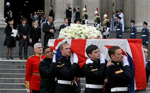 Members of Margaret Thatcher's family watch as the coffin is carried away after the funeral of former British Prime Minister Margaret Thatcher at St Paul's Cathedral in London April 17, 2013. (AP Photo/Alastair Grant)