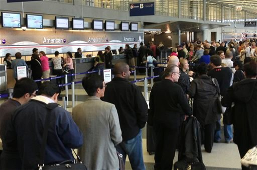 In this cell phone image, passengers are lined up at the American Airlines ticket counters at Chicago's O'Hare International Airport Tuesday, April 16, 2013.  (AP Photo/Bob Brant)
