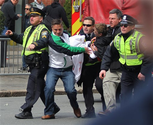 In this Monday, April 15, 2013, photo, emergency personnel carry a wounded person away from the scene of an explosion at the 2013 Boston Marathon in Boston. (AP)