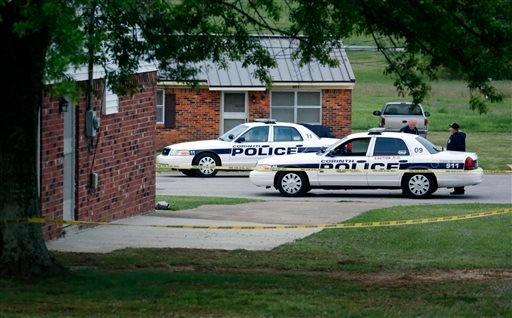 A City of Corinth police car prevents access to a house in the West Hills Subdivision in Corinth, Miss. on Thursday morning, April 18, 2013. (AP Photo/Rogelio V. Solis)