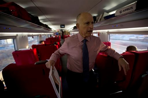 California Gov. Jerry Brown speaks to journalists on board a high speed rail leaving from the Beijing South train station in Beijing, China, Thursday, April 11, 2013. (AP)