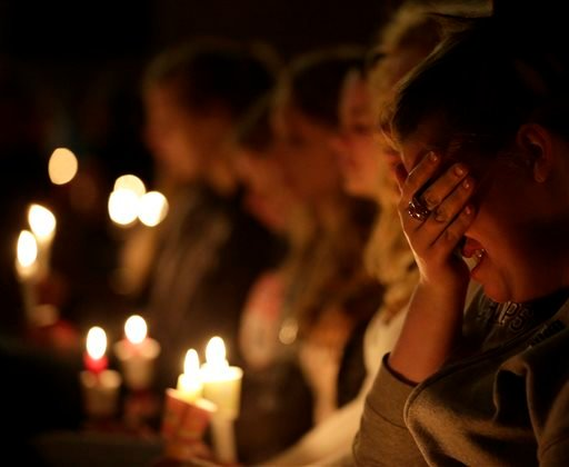 Mourners attend a service at St. Mary's Church of the Assumption Thursday, April 18, 2013, a day after an explosion at a fertilizer plant in West, Texas. (AP Photo/Charlie Riedel)