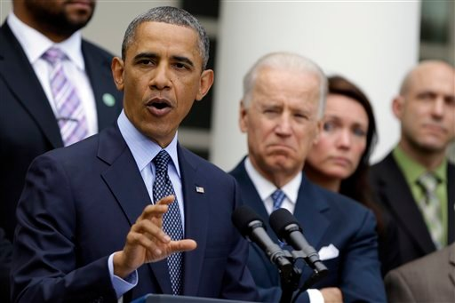 President Barack Obama, next to Vice President Joe Biden, speaks during a news conference in the Rose Garden of the White House April 17, 2013, about the defeat in the Senate of a bill to expand background checks on guns. (AP Photo/Manuel Balce Ceneta)