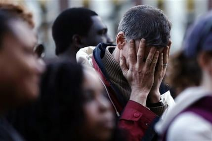 Wednesday, April 17, 2013 file photo, a mourner reacts during a candlelight vigil at City Hall in Cambridge, Mass. in the aftermath of Monday's Boston Marathon explosions.(AP Photo/Matt Rourke, File)
