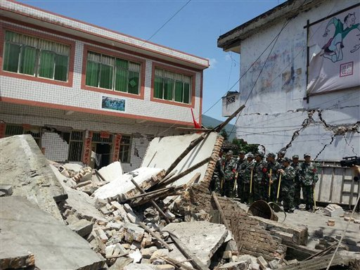 photo released by China's Xinhua news agency, buildings are destroyed by a powerful earthquake at Gucheng village of Longmen Township of Lushan County in Ya'an City. (AP Photo/Xinhua, Hai Mingwei)