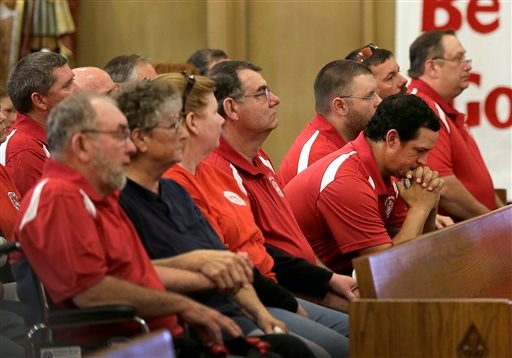 Members of the West Volunteer Fire Department listen to a service at St. Mary's Church of the Assumption, Friday, April 19, 2013, two days after an explosion at a fertilizer plant in West, Texas.(AP Photo/Charlie Riedel)