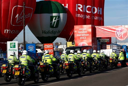 British police officers gather at the start at Blackheath during the London Marathon in London, Sunday, April 21, 2013. (AP Photo/Sang Tan)