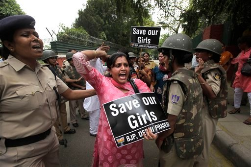 An Indian women activist of India main opposition Bharatiya Janata Party shouts slogans outside ruling United Progressive Alliance chairperson Sonia Gandhi's residence during a protest against the rape of a 5-year-old girl. (AP Photo/Manish Swarup)