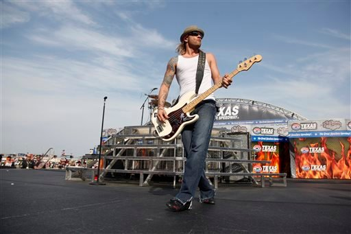 In this April 9, 2011 file photo, 3 Doors Down' bassist Todd Harrell performs before a NASCAR auto race at Texas Motor Speedway in Fort Worth, Texas. (AP Photo/Tim Sharp, File)