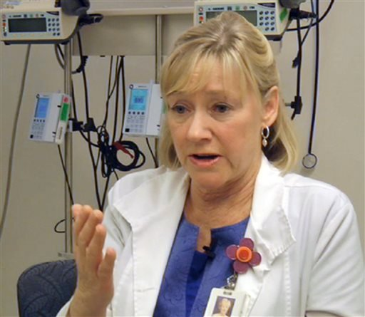 In this frame grab from Saturday, April 20, 2013, video, Massachusetts General Hospital nurse Jean Acquadra talks about the horrific early hours as bloody patients poured in after the explosions at the Boston Marathon. (AP Photo/Carla K. Johnson)