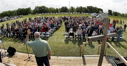 Pastor John Crowder delivers a sermon during a service for the First Baptist Church held in a field Sunday, April 21, 2013, four days after an explosion at a fertilizer plant in West, Texas. (AP Photo/Charlie Riedel)