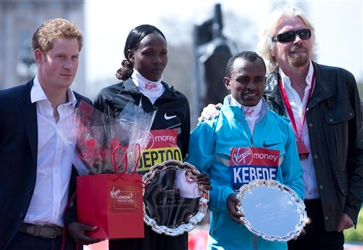 Tsegaye Kebede of Ethiopia, second right, winner of the men's marathon, Priscah Jeptoo of Kenya, second left, winner of the women's marathon with Britain's Prince Harry, left, and British businessman Richard Branson, right, pose together.