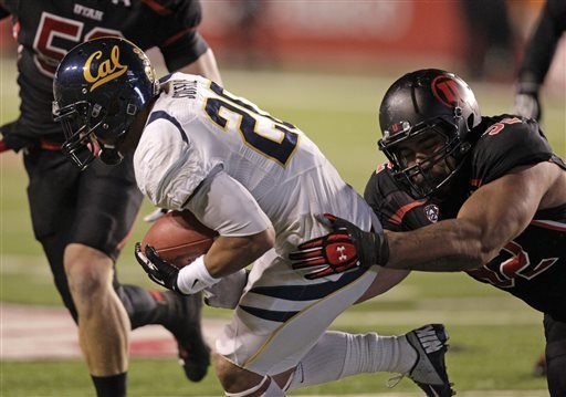 FILE - This Oct. 27, 2012, file photo, Utah defensive tackle Star Lotulelei (92) tackles California running back Isi Sofele (20) in the first quarter during an NCAA college football game, in Salt Lake City. (AP)