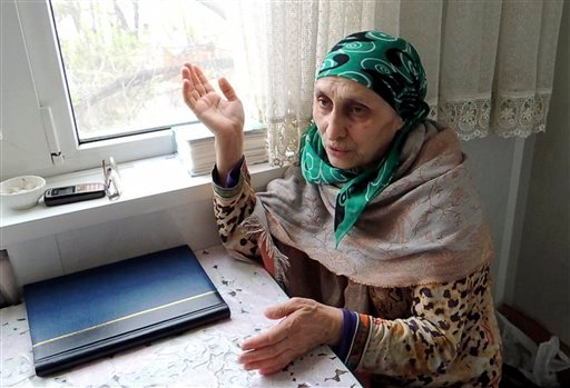 In this image taken from a video, Patimat Suleimanova, the aunt of USA Boston bomb suspects, speaks to The Associated Press in her home in the Russian city of Makhachkala, Monday April 22, 2013. (AP)