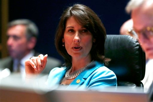 National Transportation Safety Board (NTSB) Chair Deborah Hersman participates a hearing investigating a battery fire aboard a Boeing 787, Tuesday, April 23, 2013, at the NTSB in Washington. (AP Photo/Charles Dharapak)