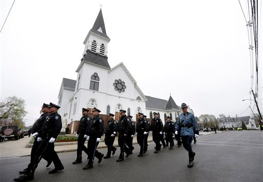 Massachusetts Institute of Technology police officers march as they depart St. Patrick's Church in Stoneham, Mass., following a funeral Mass for MIT police officer Sean Collier, Tuesday, April 23, 2013. (AP)