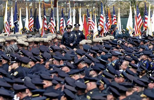 Police officers arrive to a memorial service for fallen Massachusetts Institute of Technology campus officer Sean Collier at MIT in Cambridge, Mass. Wednesday, April 24, 2013. (AP Photo/Elise Amendola)