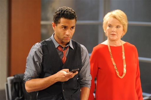 """March 18, 2013 publicity photo released by The Online Network shows Corbin Bleu as Jeffrey King, left, and Erika Slezak as Victoria Lord, on the set of """"One Life To Live"""" in Stamford, Conn.(AP Photo/The Online Network, David M. Russell)"""