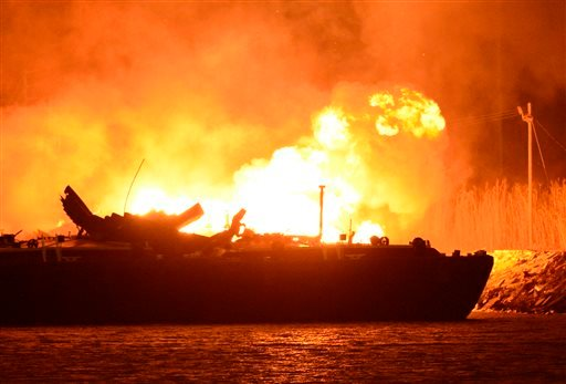 A massive explosion at 3a.m. EDT on one of the two barges still ablaze in the Mobile River in Mobile, Ala., on Thursday, April 25, 2013.(AP Photo John David Mercer)