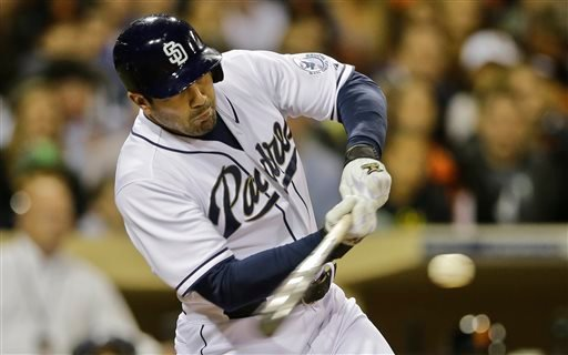 San Diego Padres' Carlos Quentin connects for a base hit and drives in teammate Andrew Cashner in the third inning of baseball game in San Diego, Friday, April 26, 2013. (AP photo/Lenny Ignelzi)