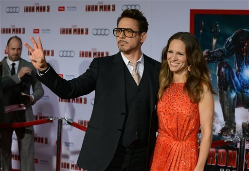 "Robert Downey Jr., left, and Susan Downey arrive at the world premiere of ""Marvel's Iron Man 3"" at the El Capitan Theatre on Wednesday, April 24, 2013, in Los Angeles, Calif. (Photo by Jordan Strauss/Invision/AP)"