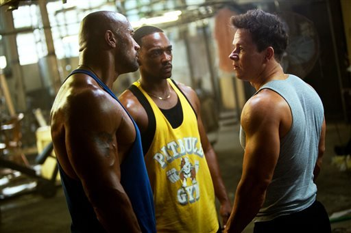 "This film image released by Paramount Pictures shows, from left, Dwayne Johnson, Anthony Mackie and Mark Wahlberg in a scene from ""Pain and Gain."" (AP Photo/Paramount Pictures, Jaime Trueblood)"
