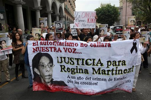 Journalists march together during a protest to demand justice in the Regina Martinez case, a journalist killed a year ago and an end to more recent attacks on the press in Veracruz, Mexico, Sunday April 28, 2013.