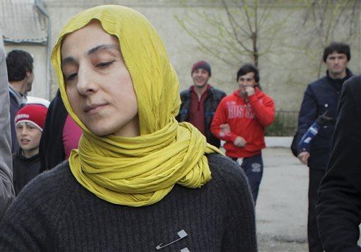 Zubeidat Tsarnaeva, mother of Tamerlan and Dzhokhar Tsarnaev, the two men accused of setting off bombs near the Boston Marathon finish line on April 15, 2013 in Boston, walks near her home in Makhachkala, Dagestan, southern Russia, Tuesday, April 23, 2013