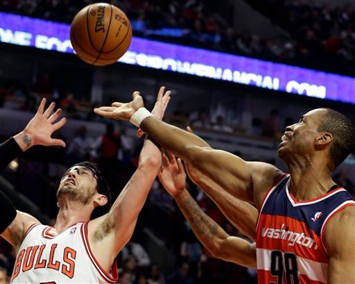 FILE - In this April 17, 2013 file photo, Washington Wizards center Jason Collins, right, battles for a rebound against Chicago Bulls guard Kirk Hinrich during the first half of an NBA basketball game in Chicago. (AP)