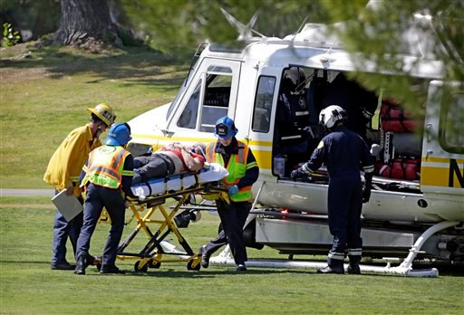 A victim is wheeled into an ambulance, at Westlake Village Golf Course, where a single-engine plane made an emergency landing Monday, April 29, 2013. Three people received minor injuries. (AP Photo/Los Angeles Times, Ricardo DeAratanha)