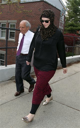 April 29, 2013 file photo, Katherine Russell, wife of Boston Marathon bomber suspect Tamerlan Tsarnaev, right, leaves the law office of DeLuca and Weizenbaum with Amato DeLuca, in Providence, R.I.(AP Photo/Stew Milne, File)