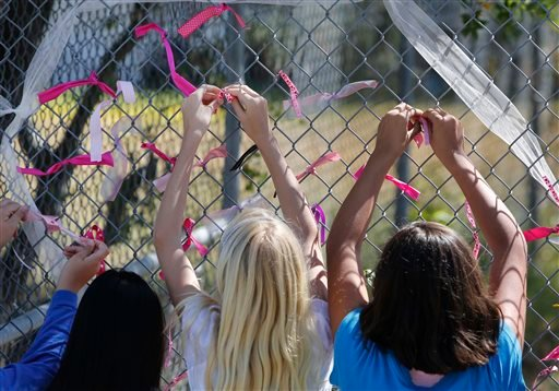 Students at Jenny Lind Elementary School tie ribbons honoring murder victim Leila Fowler, in Valley Springs, Calif., Monday April 29, 2013.(AP Photo/Rich Pedroncelli)