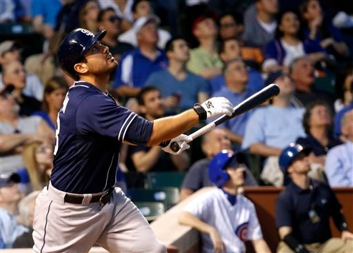 San Diego Padres' Carlos Quentin watches his sacrafice fly off Chicago Cubs starting pitcher Edwin Jackson, scoring Everth Cabrera, during the third inning of a baseball game, Tuesday, April 30, 2013, in Chicago. (AP Photo/Charles Rex Arbogast)