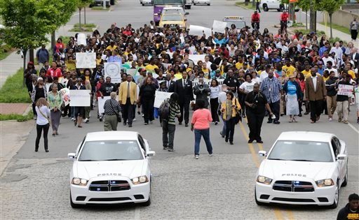 Police provide an escort as thousands of young students march through downtown Birmingham, Ala., Thursday, May 2, 2013. (AP)