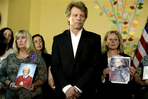 Singer Jon Bon Jovi, center, stands next to Pamela Sanquini, left, whose son Matthew overdose at the age of 20, and Jill LaZare, right, whose daughter Brooke overdose at age 23.