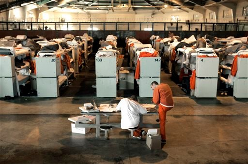 FILE -- In this Aug. 3, 2006 file photo, inmates are housed in three-tier bunks, in what was once a multi-purpose recreation room, at the Deuel Vocational Institution in Tracy, Calif. (AP)