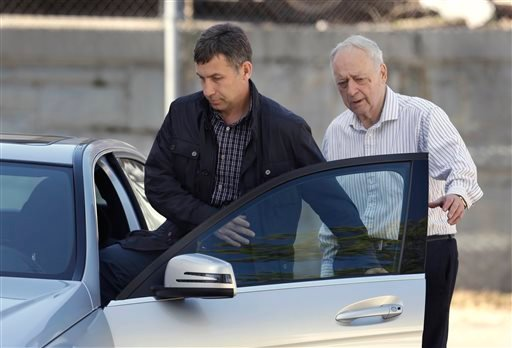 Ruslan Tsarni, left, uncle of killed Boston Marathon bombing suspect Tamerlan Tsarnaev, departs the Graham, Putnam, and Mahoney Funeral Parlors, in Worcester, Mass., as funeral director and owner Peter Stefan, walks him to his car, Sunday, May 5, 2013.