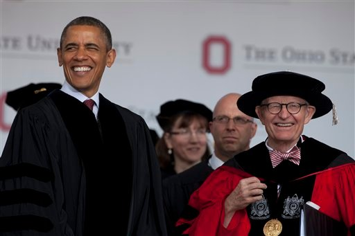 President Barack Obama and Ohio State University President E. Gordon Gee arrive at the Ohio State University spring commencement in the Ohio Stadium, Sunday, May 5, 2013, in Columbus, Ohio.