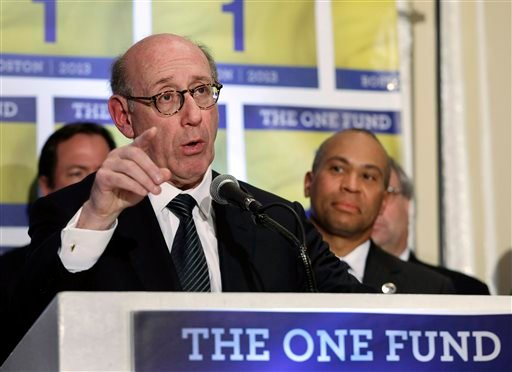 In this April 23, 2013 file photo, Kenneth Feinberg, an attorney who managed the 9/11 Victim Compensation Fund, speaks at a news conference in Boston as Massachusetts Gov. Deval Patrick, right, listens.