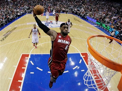 In this March 13, 2013, file photo, Miami Heat's LeBron James goes up for a dunk in the first half of an NBA basketball game against the Philadelphia 76ers in Philadelphia.