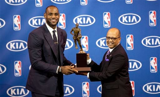 Miami Heat's LeBron James, left, and Kia Motors' Percy Vaughn pose for photos during an NBA basketball news conference, Sunday, May, 5, 2013, in Miami.