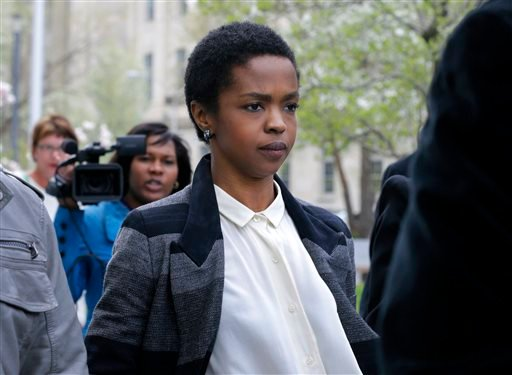 FILE - This April 22, 2013 file photo shows singer Lauryn Hill walking from federal court in Newark, N.J. Hill is facing sentencing Monday, May 6, on federal tax charges. (AP)