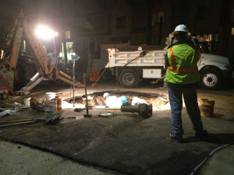 Photos show flooding and damage in North Park after a water main break. Crews worked overnight to repair the damage and restore water to residents.
