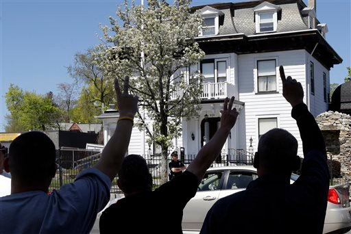 Protesters gesture outside the Graham, Putnam, and Mahoney Funeral Parlors in Worcester, Mass., Monday, May 6, 2013, where the body of killed Boston Marathon bombing suspect Tamerlan Tsarnaev is being prepared for burial.