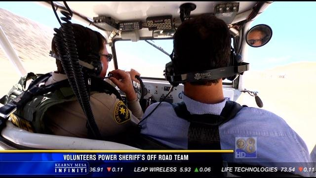 ORET team member Bill Simpson and News 8's Carlo Cecchetto respond to a call.