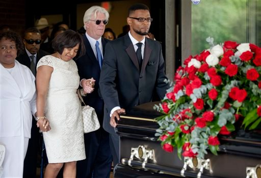 Donna Kelly Pratte, second from left, the mother of Kris Kross rapper Chris Kelly, follows the casket of her son during his funeral recessional along with her husband James Pratte, second right, Thursday, May 9, 2013, in Atlanta. (AP)