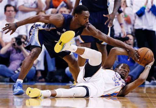 Oklahoma City Thunder's Kevin Durant slips and falls as Memphis Grizzlies Tony Allen blocks his pass during the final seconds of Game 2 of their Western Conference Semifinals NBA basketball playoff series in Oklahoma City, Tuesday, May 7, 2013. (AP Photo)