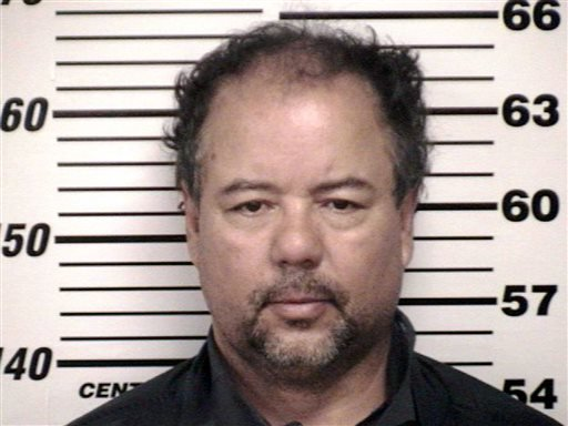 This image provided by the Cuyahoga County Sheriff's office shows the Cuyahoga County Corrections Center booking photo of Ariel Castro, 52, after he was ordered to be held on $8 million bail Thursday, May 9, 2013, in Cleveland.