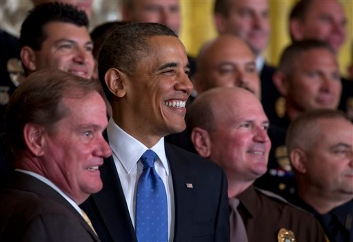 President Barack Obama stands for a photo 2013 National Association of Police Organizations (NAPO) TOP COPS award winners during a ceremony in East Room of the White House, Saturday, May 11, 2013, in Washington. Left of Obama is NAPO President Tom Nee.